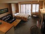 Suite 210_Livingroom_Murphy_Bed_Down_5x7